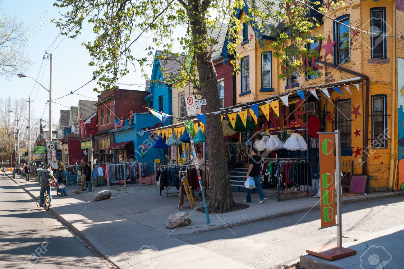 TORONTO, CANADA - MAY 2, 2007: Houses and shops in Kensington in Toronto. Kensington Market is a  multicultural neighbourhood in the city and was  proclaimed a National Historic Site of Canada in November 2006.